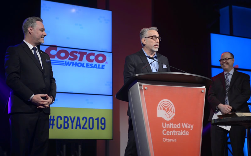 A photo of Costco representatives making a speech at the CBYA Gala.