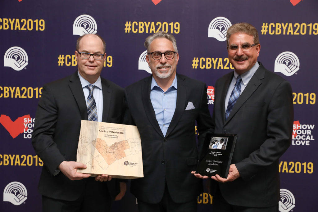 A photo of Costco representatives receiving their CBYA Award.