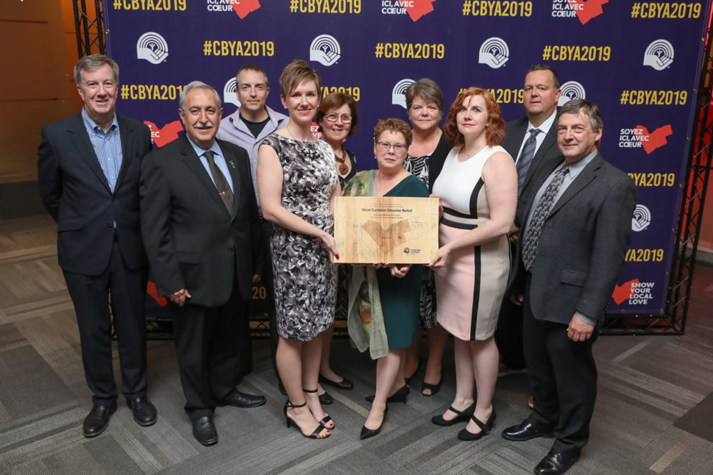 A photo of the Trend-Arlington Community Association and West Carleton Disaster Relief with their award at the CBYA Gala.