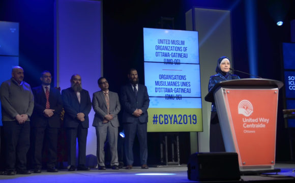 A photo of The United Muslim Organizations of Ottawa-Gatineau making a speech at the CBYA Gala.