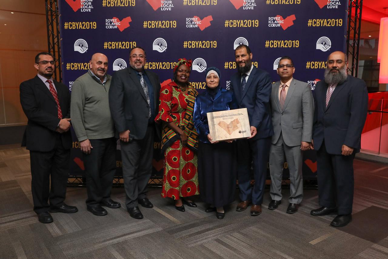 A photo of The United Muslim Organizations of Ottawa-Gatineau accepting their award at the CBYA Gala.