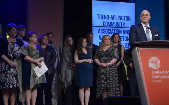 A photo of the Trend-Arlington Community Association and West Carleton Disaster Relief accepting their award at the CBYA Gala.