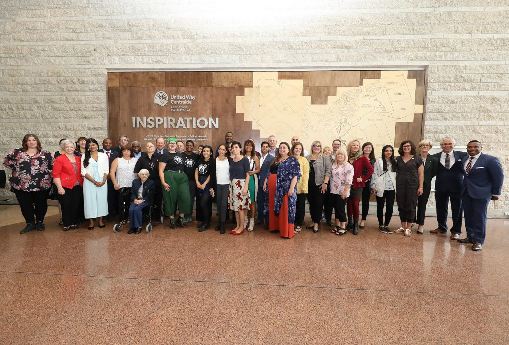 Community Builders in Ottawa in front of the Wall of Inspiration