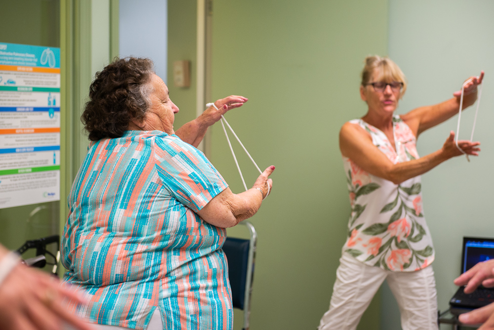 Alice participating in an seniors' exercise class with Katherine