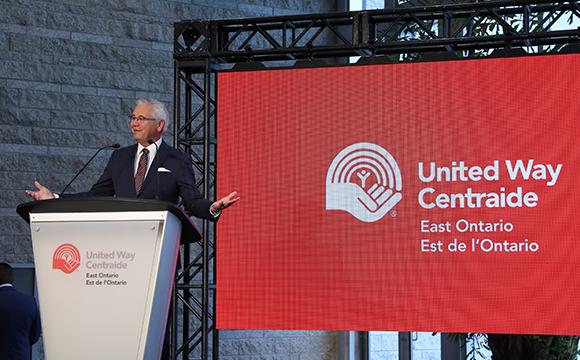 Michael Allen on stage talking about United Way East Ontario