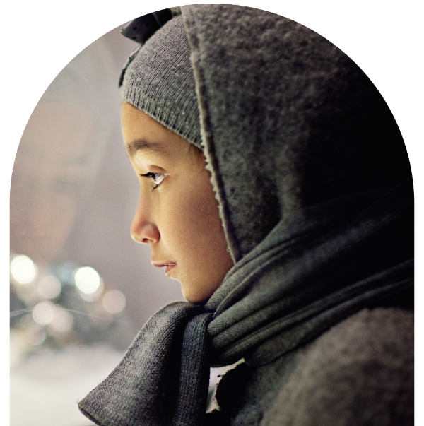 A photo of a young women alone out in the cold.