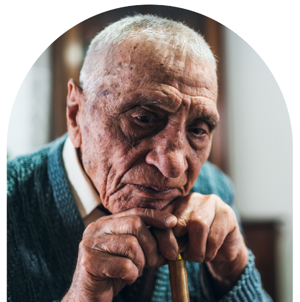 A photo of a senior man alone leaning on his cane.